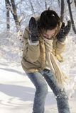 Girl fighting with snow balls Stock Photography