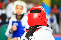 Girl fighting on stage during Taekwondo contest Stock Photography