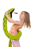 Girl fights with toy snake stock photo