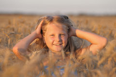 The girl in filed wheats. Royalty Free Stock Image