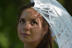 Girl with a filigree umbrella Stock Photo