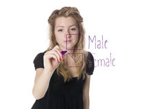 Girl filling in the gender box. Towards white background royalty free stock photos