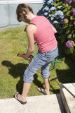 Girl filling water gun Stock Photography