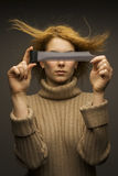 Girl with film. Girl that hide her eyes behind photographic film Royalty Free Stock Images