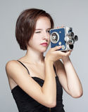 Girl with film camera Stock Images