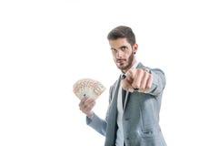 girl financier tient un paquet de plaisir des dollars Vous pourriez être prochain Photo stock