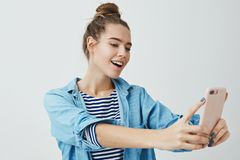 Girl finding angle take awesome selfie post online internet. Attractive stylish fashionable woman making selfie royalty free stock photo
