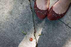 Girl finds a penny on the sidewalk. Royalty Free Stock Photo