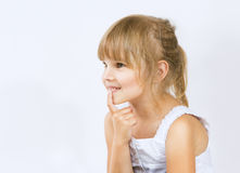 Girl with finger into his mouth. Little girl with finger into his mouth, little girl looking with interest (curiosity Royalty Free Stock Photos
