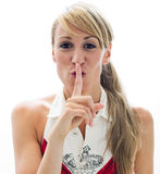 Girl with finger on lips asking for silence Royalty Free Stock Photo