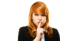 Girl with finger on lips hush hand gesture stock images