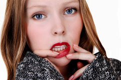 Girl with finger on lips. Royalty Free Stock Image
