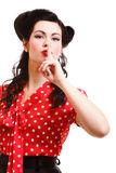 Girl finger near mouth silence gesture Royalty Free Stock Photography