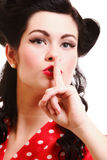 Girl finger near mouth silence gesture Royalty Free Stock Images