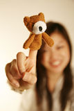Girl with finger puppet bear Royalty Free Stock Photos