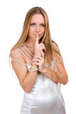 Girl with finger to her lips Royalty Free Stock Image
