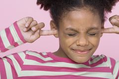 Girl With Fingers In Ears Royalty Free Stock Image