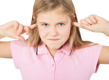 Girl with fingers in ears Stock Photos