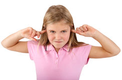 Girl with fingers in ears Stock Photo