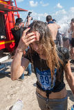 Girl after finishing of race and water procedure Stock Photography