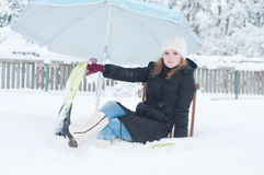 Girl with fins sitting in snow Stock Photography