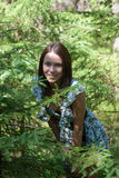 Girl in fir-tree wood Stock Images