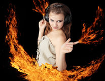 Girl - fire. Girl dances and ignites fire in the hands Royalty Free Stock Photography