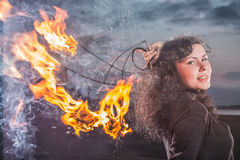 The girl and fire Stock Photography