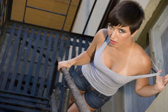 Girl Wife Beater on Fire Escape Outdoors Downtown Royalty Free Stock Photos