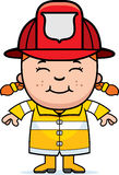 Girl Firefighter. A cartoon illustration of a firefighter girl standing and smiling Royalty Free Stock Image