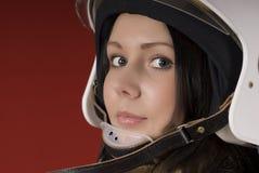 Girl in a fireman`s helmet Stock Photo