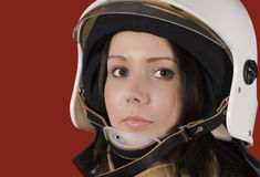 Girl in a fireman`s helmet Stock Images