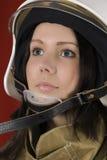 Girl in a fireman`s helmet Stock Image