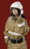 Girl in fireman uniform Stock Images