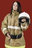 Girl in fireman uniform Royalty Free Stock Photos