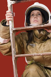 Girl in fireman uniform upstairs Royalty Free Stock Images