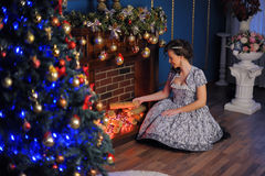 Girl at the fireplace at Christmas Stock Photo