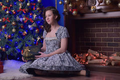 Girl at the fireplace at Christmas Royalty Free Stock Images