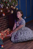 Girl at the fireplace at Christmas Stock Photos