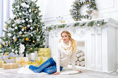Girl by the fireplace Royalty Free Stock Images