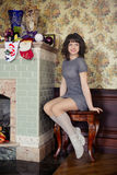 The girl in the fireplace new year. The concept of the holiday Stock Image
