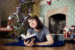 The girl in the fireplace new year. The concept of the holiday Royalty Free Stock Photo