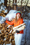 The girl with firewood in the winter Royalty Free Stock Images
