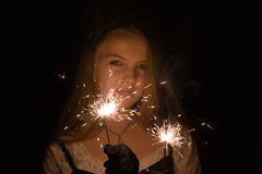 Girl with fireworks Royalty Free Stock Image