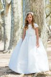 Girl in first communion dress. Royalty Free Stock Images