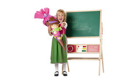 Girl on first school day shows thumb Royalty Free Stock Photos