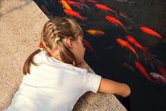 Girl and fish Stock Photo