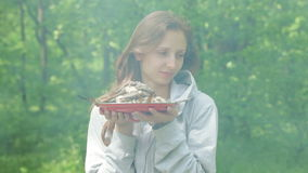 Girl with fish in nature stock footage