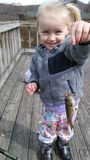 Girl with fish. Toddler showing off her first fish. Taken at the Rouse home pond in Youngsville Pennsylvania Royalty Free Stock Photography