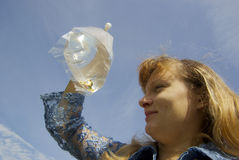 Girl with fishes. Happy girl holds poket with aquarium fishes Stock Photo